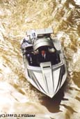 Stuntman Wade Eastwood in James Bonds Q boat on the River Thames in London